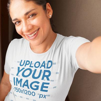Selfie Mockup of a Hispanic Woman Wearing a Tshirt a16016