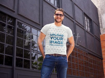 Young Happy Guy Wearing a Round Neck Tee Template While Outside a Closed Bar a16003