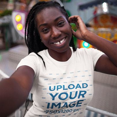 Happy Young Customer with Dreadlocks Wearing a T-Shirt Mockup While Taking a Selfie a16005
