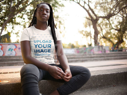 Young Girl with Dreadlocks Wearing a Tshirt Template While Sitting Down in the City a15945