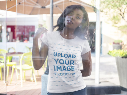 Through the Window Mockup of a Black Girl Wearing a Round Neck Tee a16054