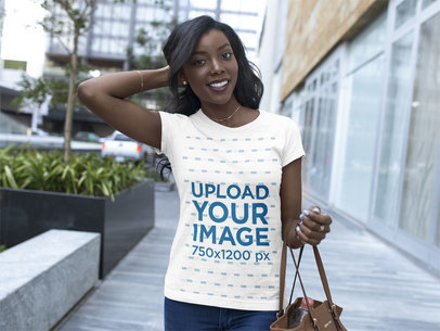 Mockup of a Happy Young Girl Wearing a Round Neck Tee While Walking in the City a16049