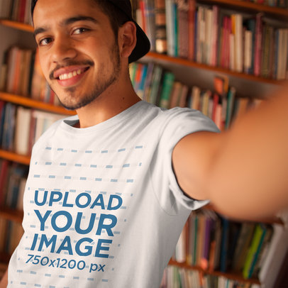 Selfie Mockup of a Young Dude Wearing a Round Neck Tee at a Library a16021