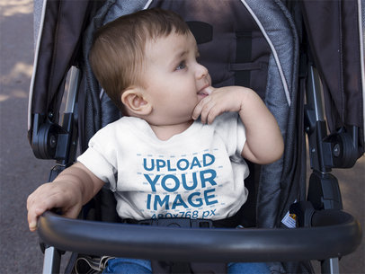 Mockup of a Baby Boy Wearing a Round Neck Tshirt Template While on his Stroller a16089