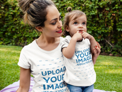 Mockup of a Mom and her Baby Boy Wearing Different Round Neck Tees Mockup While Outdoors a16075