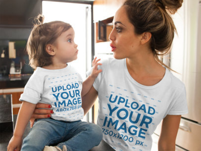 Mom with her Girl Wearing T-Shirts Mockup While Doing Faces to Each Other a16093