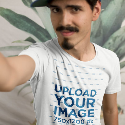 Young Customer Taking a Selfie While Wearing a T-Shirt Mockup a16217