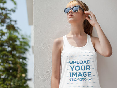 Beautiful Young Girl Wearing a Bella Flowie Tank Top Mockup While Looking to the Sky a16119