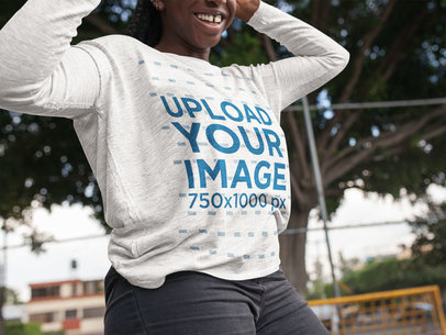 Mockup of a Black Girl Wearing a Long Sleeve Heather Tee While at the Park a16205