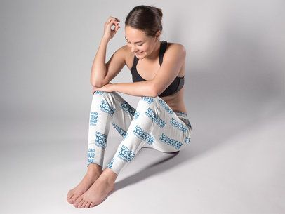 Smiling White Girl Wearing Sweatpants Mockup While in a Studio a15587