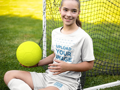 Custom Soccer Jerseys - Happy Girl Sitting Down with the Ball a16389