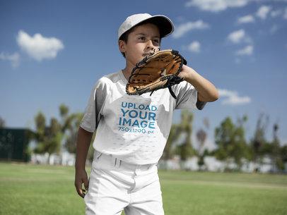 Baseball Uniform Designer - Boy Wearing a Raglan Tee Mockup About to Catch the Ball a16378