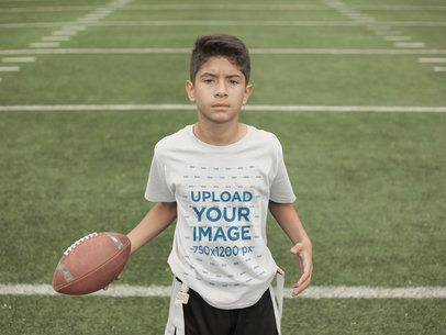 Custom Football Jerseys - Kid Holding the Ball at the Field a16476