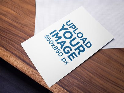 Poster Mockup Lying on a Wood Table a16306