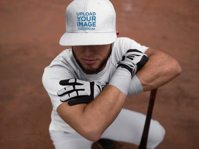 Batter Squatting While Wearing a Baseball Hat Mockup a16241