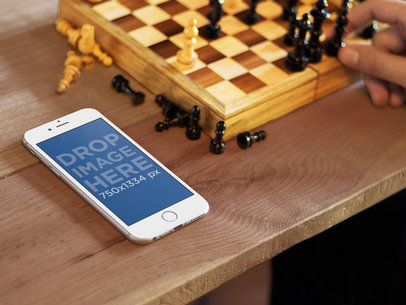 White iPhone 6 While Playing Chess