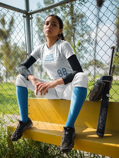 Custom Softball Jerseys - Girl Sitting on a Bench Near the Bat and Glove a16723