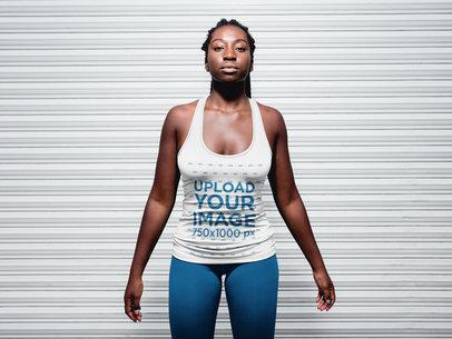 Black Girl with Dreadlocks wearing a Tank Top Against a Metallic Curtain a16750