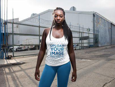 Girl With Dreadlocks Wearing Tank Top Mockup in an Industrial Area a16745