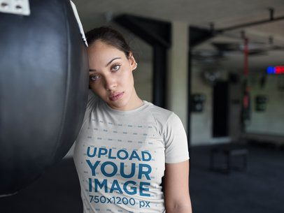 Beautiful Girl Resting at the Gym While Wearing Custom Sportswear Mockup a16834