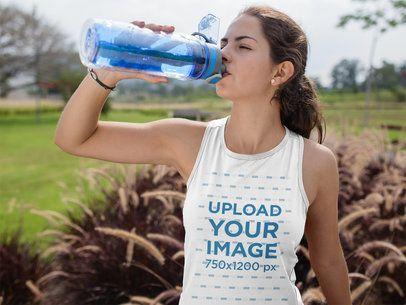 Teen Girl Drinking Water While Wearing Custom Sportswear Mockup Outdoorsa16852