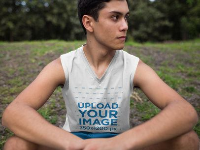 Teenager Sitting Down After Exercise While Wearing Custom Sportswear Mockup a16859
