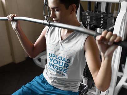 Teenager Lifting Weights at the Gym While Wearing Custom Sportswear Mockup a16855