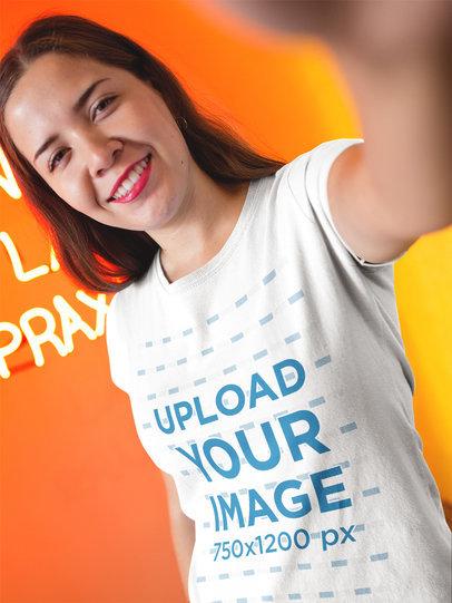 Selfie Mockup of a Girl Wearing a T-Shirt Inside an Orange Room a16920