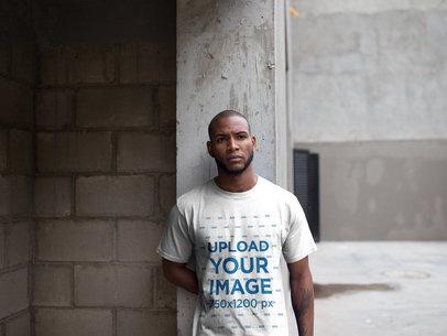 Mockup of a Man Wearing a T-Shirt While at a Warehouse Entrance a16900