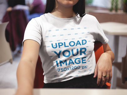 Mockup of a Cropped Face Girl Wearing a T-Shirt Indoors a16968
