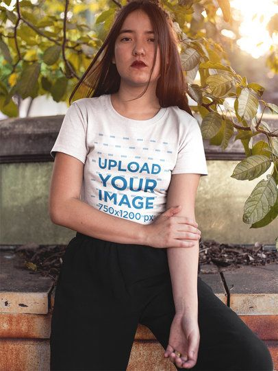 Mockup of a Serious Woman Wearing a T-Shirt While Sitting on a Park a16964