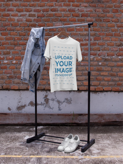 Mockup of a T-Shirt on a Hanger While Against a Bricks Wall a16951