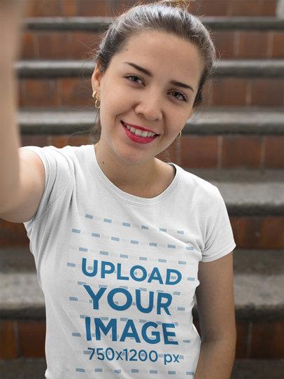 Selfie Mockup of a Girl Wearing a T-Shirt Near Stairways a16911