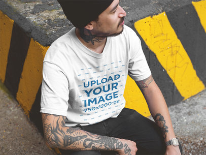 Mockup of a Tattooed Man Wearing a T-Shirt While at an Urban Area a17077