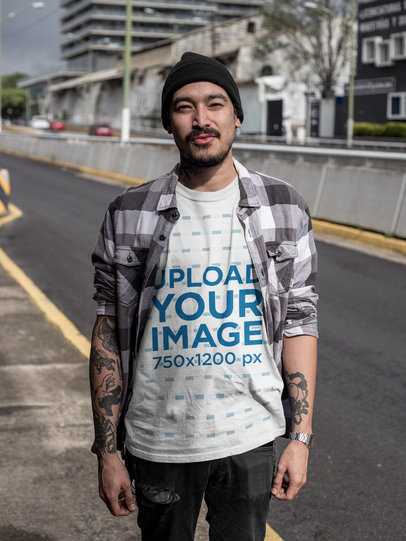 Tattooed Asian Man with Attitude Walking Alongside the Road Wearing a T-Shirt Mockup a17068