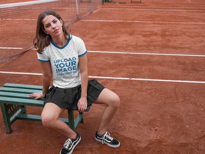 Pretty Girl Wearing a Ringer Tshirt Mockup While at the Tennis Court a17064