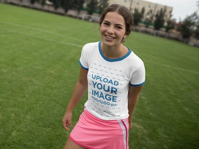 Smiling Girl Wearing a Pink Skirt and a Ringer T-Shirt Mockup while Outdoors a17055