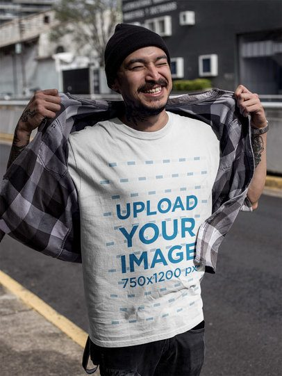 Smiling Tattooed Asian Man Wearing a Round Neck T-Shirt Mockup Outdoors a17067