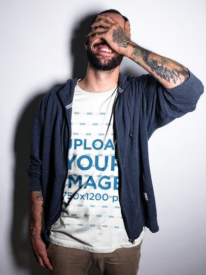 Smiling Tattooed Man Wearing a T-Shirt While at a Studio Mockup a17024