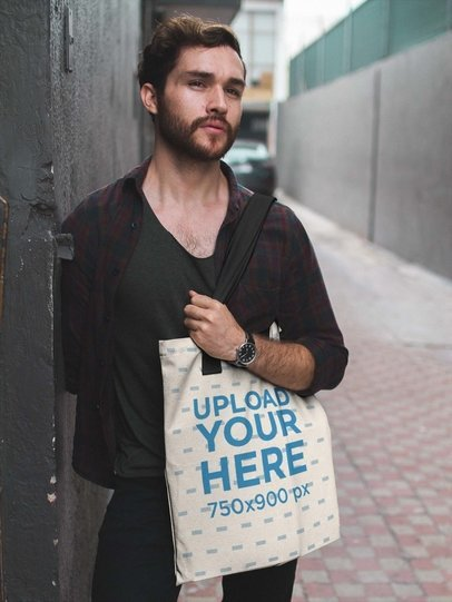 Dude Standing in an Alley While Carrying a Tote Bag Mockup a17094