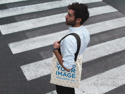 Man Crossing the Street While Carrying a Tote Bag Mockup a17102