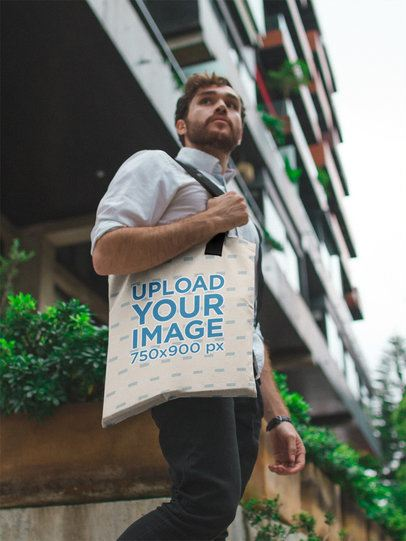 Man with a Tote Bag Mockup in the City a17100