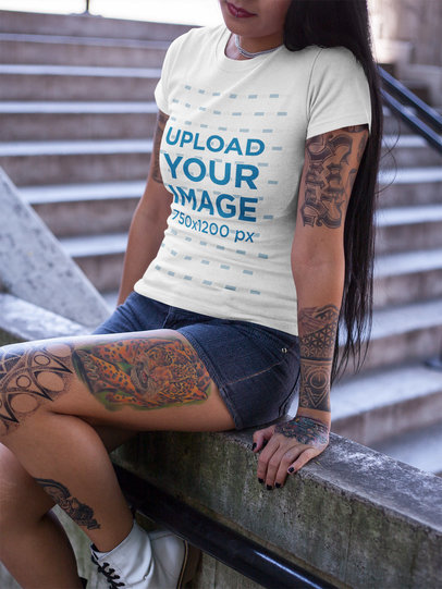 Tattooed Cropped Face Girl Wearing a T-Shirt Mockup Sitting Near Concrete Stairways a17148