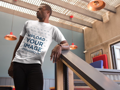 Mockup of a  Black Man Hanging out at a Terrace While Wearing a Round Neck Tee 17167