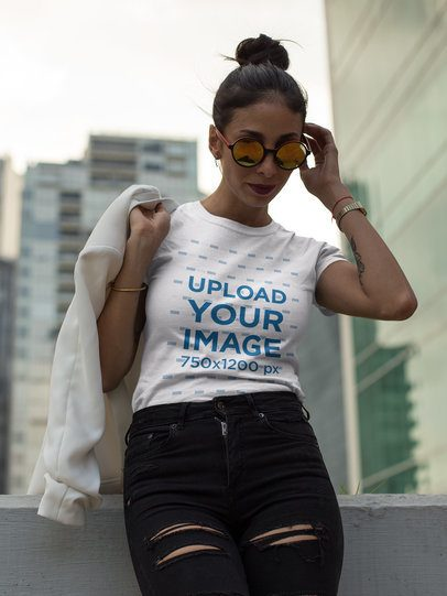 Fashion Girl Looking at the Floor While Wearing a T-Shirt Mockup a17253