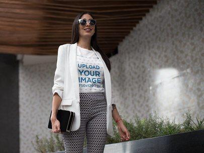 Girl Wearing a T-Shirt Mockup While Walking at the Mall a17242