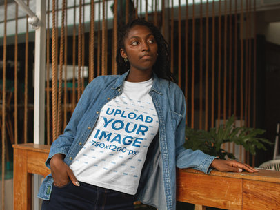 Black Girl Wearing a T-Shirt Mockup While Waiting at the Restaurant a17325