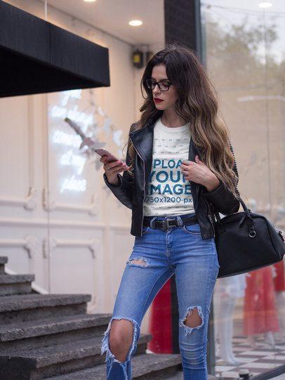 Beautiful Hispanic Fashion Woman Wearing a Round Neck Tee Mockup While Outside a Store a17352