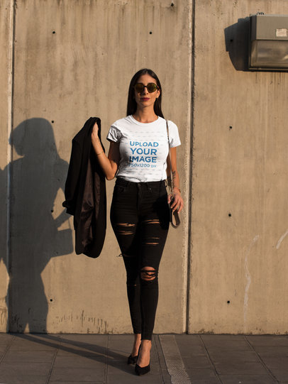 Pretty Fashion Woman Wearing a Round Neck Tee Mockup Walking Against a Concrete Wall a17244