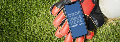 Mockup of an iPhone X Lying on a Soccer Field a17391